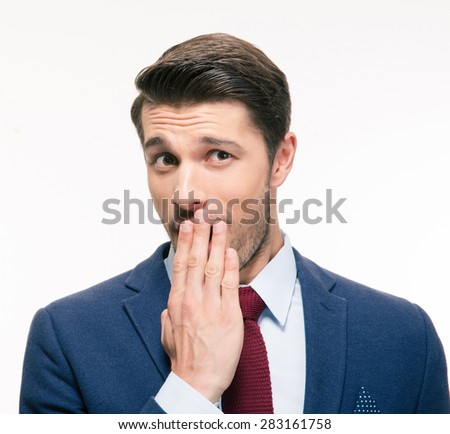 Businessman covering his mouth isolated on a white background. Looking at camera - stock photo