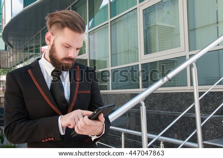 Businessman creates a plan at the tablet, making adjustments to the scheme