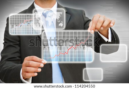 Businessman creating digital graphic - stock photo