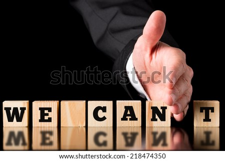 Businessman Creating Positive Statement from Negative Statement by Cutting Blocks with Hand. - stock photo