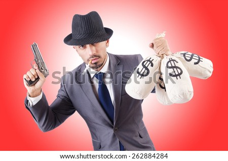 Businessman criminal with sacks of money - stock photo