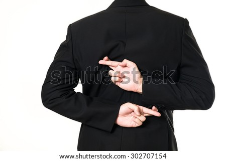 Businessman cross his finger on white background - stock photo