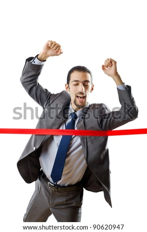 Businessman crossing finish line - stock photo