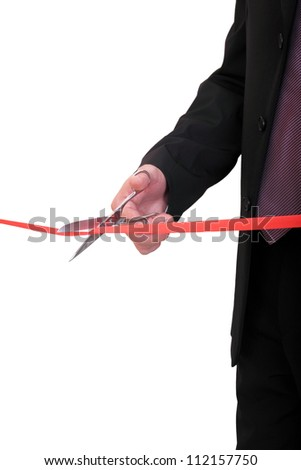 businessman cutting red ribbon - stock photo