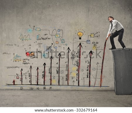 Businessman dealing with graphics - stock photo
