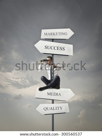 Businessman deciding which direction he should take