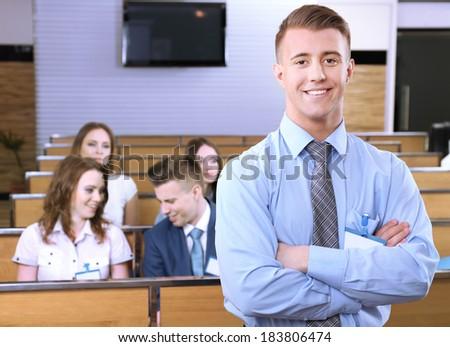 Businessman delivering presentation at conference - stock photo