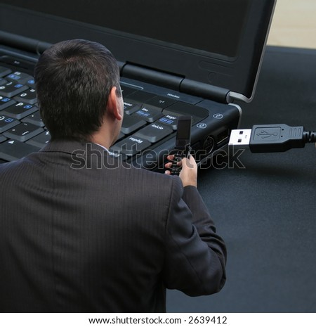 Businessman desconnecting from the internet