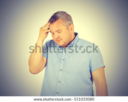 Businessman desperate, depressed, headache. Isolated on background.