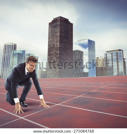 Businessman determined at the start of race - stock photo