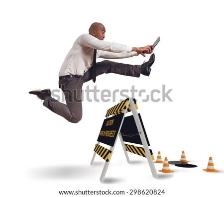 Businessman distracted trying to overcome a hazard - stock photo