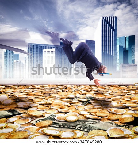 Businessman dives into the pool of money - stock photo