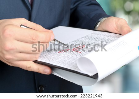 businessman  doing business, standing in the office, analyzing  data in  documents