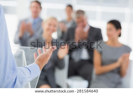 Businessman doing conference presentation in meeting room - stock photo