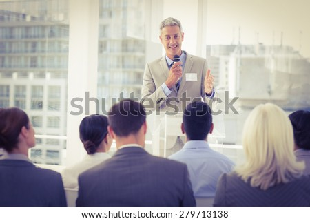 Businessman doing speech during meeting in office - stock photo