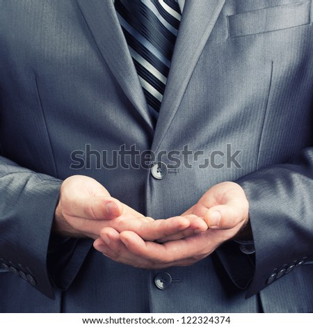 Businessman doing two palms together gesture - stock photo