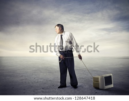 businessman drags television - stock photo