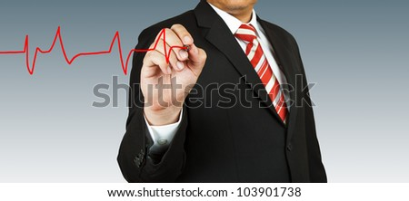Businessman draw a pulse - stock photo