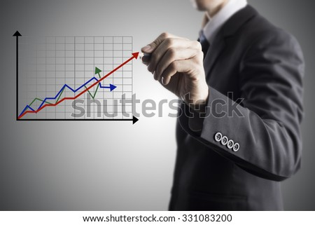 Businessman Draw Increase Revenue Graph On Transparent Screen