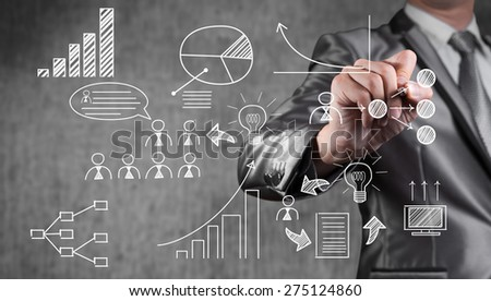 businessman draw plan by icon and financial object, business strategy concept - stock photo