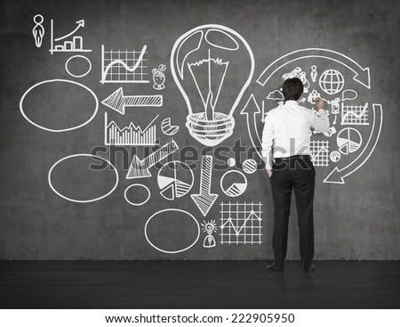 Businessman drawing a business flowchart.  - stock photo