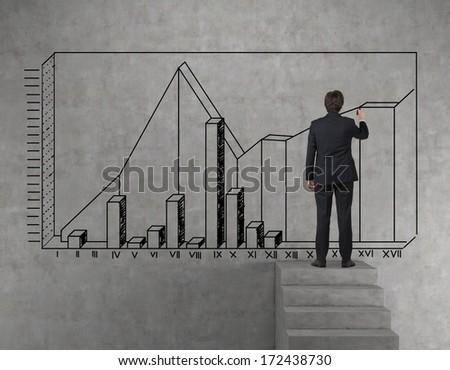 Businessman drawing a chart - stock photo