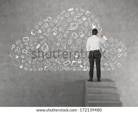 Businessman drawing a data cloud - stock photo