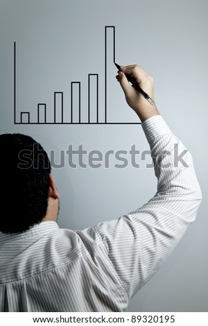 Businessman drawing a graph