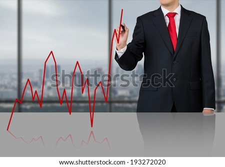 Businessman drawing a graph, red.