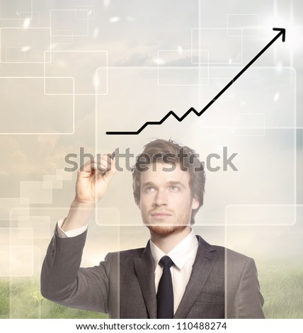 Businessman drawing a graph with black marker (growth) - stock photo