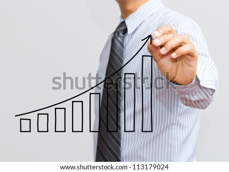 Businessman drawing a growth graph - stock photo