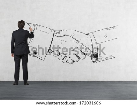 Businessman drawing a handshake