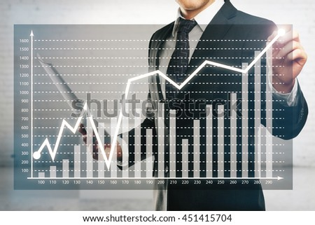 Businessman drawing abstract business diagram on blurry concrete background - stock photo