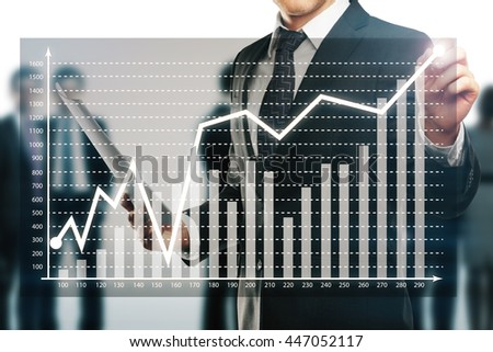 Businessman drawing abstract business graph on bright background with other businesspeople