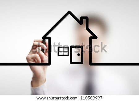 businessman drawing abstract  cottage on a white background