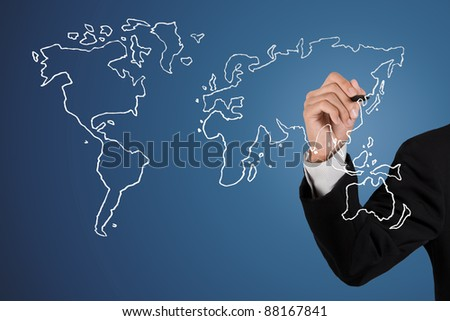Businessman drawing an earth map - stock photo