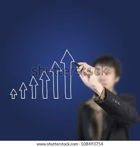 Businessman drawing arrow chart on white board - stock photo