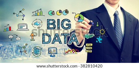Businessman drawing Big Data concept above the city - stock photo