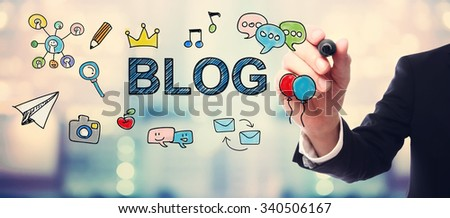 Businessman drawing Blog concept on blurred abstract background