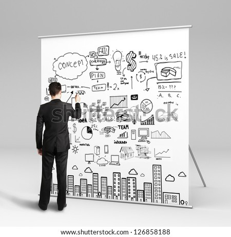 businessman drawing business concept on white table - stock photo