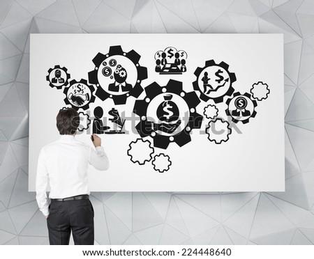 Businessman drawing business optimization scheme.  - stock photo