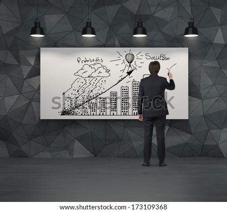 Businessman drawing business strategy graph - stock photo