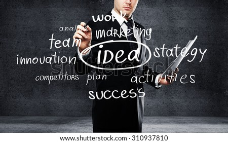 businessman drawing business tags concept - stock photo
