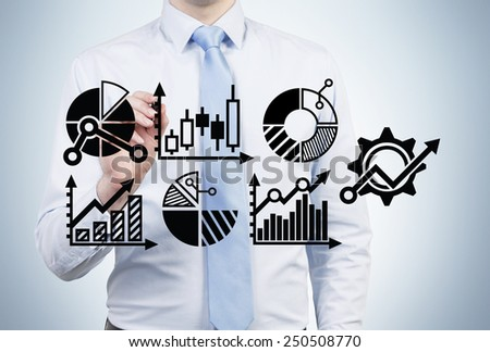 businessman drawing charts and graphs, close up - stock photo