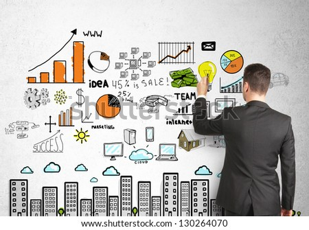businessman drawing city scheme concept - stock photo