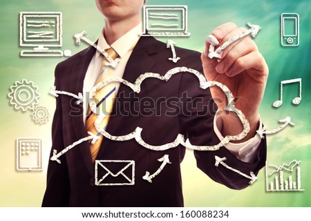 Businessman drawing cloud computing concept with white chalk - stock photo