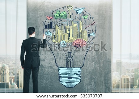 Businessman drawing creative lamp sketch in interior with grungy concrete wall and city view. Business idea concept. 3D Rendering