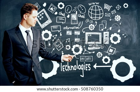Businessman drawing creative technologies, information and social media sketch on chalkboard background