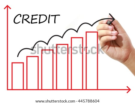 Businessman drawing CREDIT Graph on virtual screen. Business, banking, finance and investment concept.