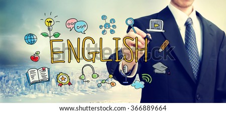 Businessman drawing English concept above the city - stock photo